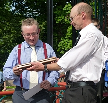 Damian receiving his baton case from Chairman, Neil Robinson